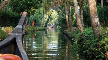 Canal boat going down the river in Kerala, India. Photo by Bennett W. Root, Jr.