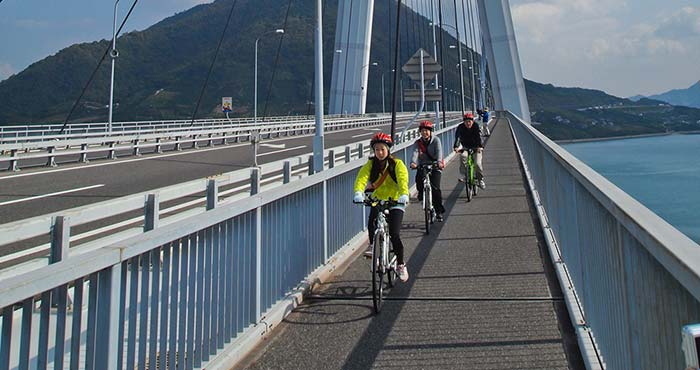 Cyclists ride on the Tatara Ohashi Bridge