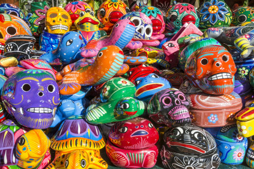 Colorful ceramic skull and animal figure souvenirs on sale at Velas Vallarta Hotel, Puerto Vallarta, Mexico.