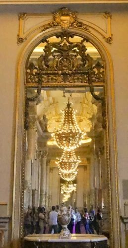 Chandelier festooned hallway at Teatro Colon