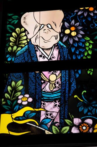 Detail of a stained glass artwork at Yonago kitaro airport in japan's tottori prefecture inaugurated on march 8 2016,birthdate of the late manga artist Shigeru Mizuki representing a yokai named konaki jiji of his epic Gegege no kitaro manga series.