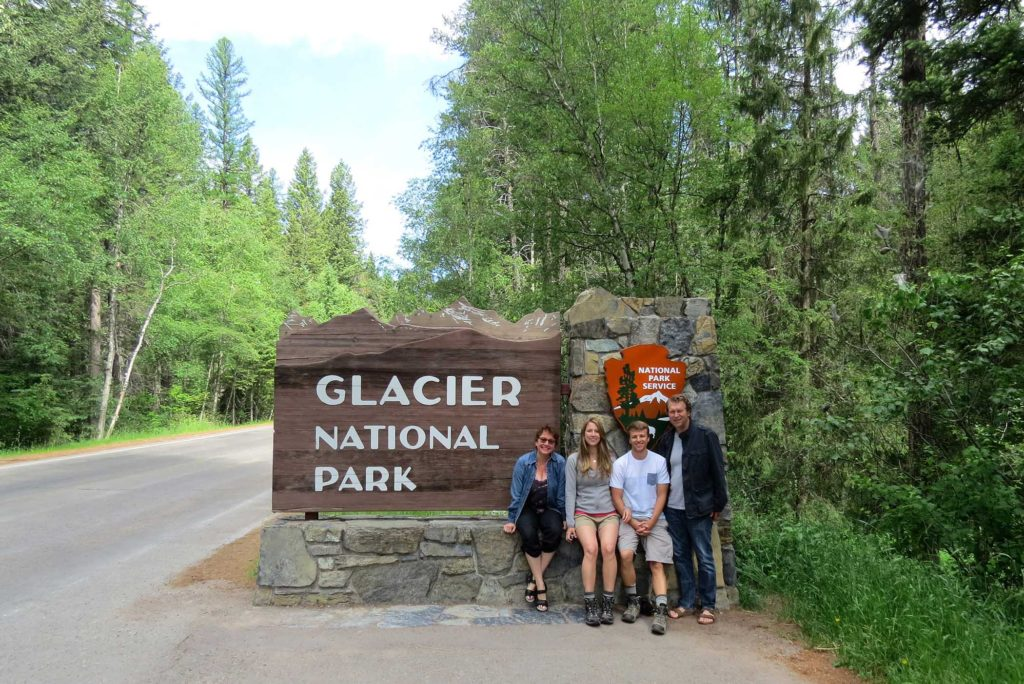 Glacier National Park sign with group