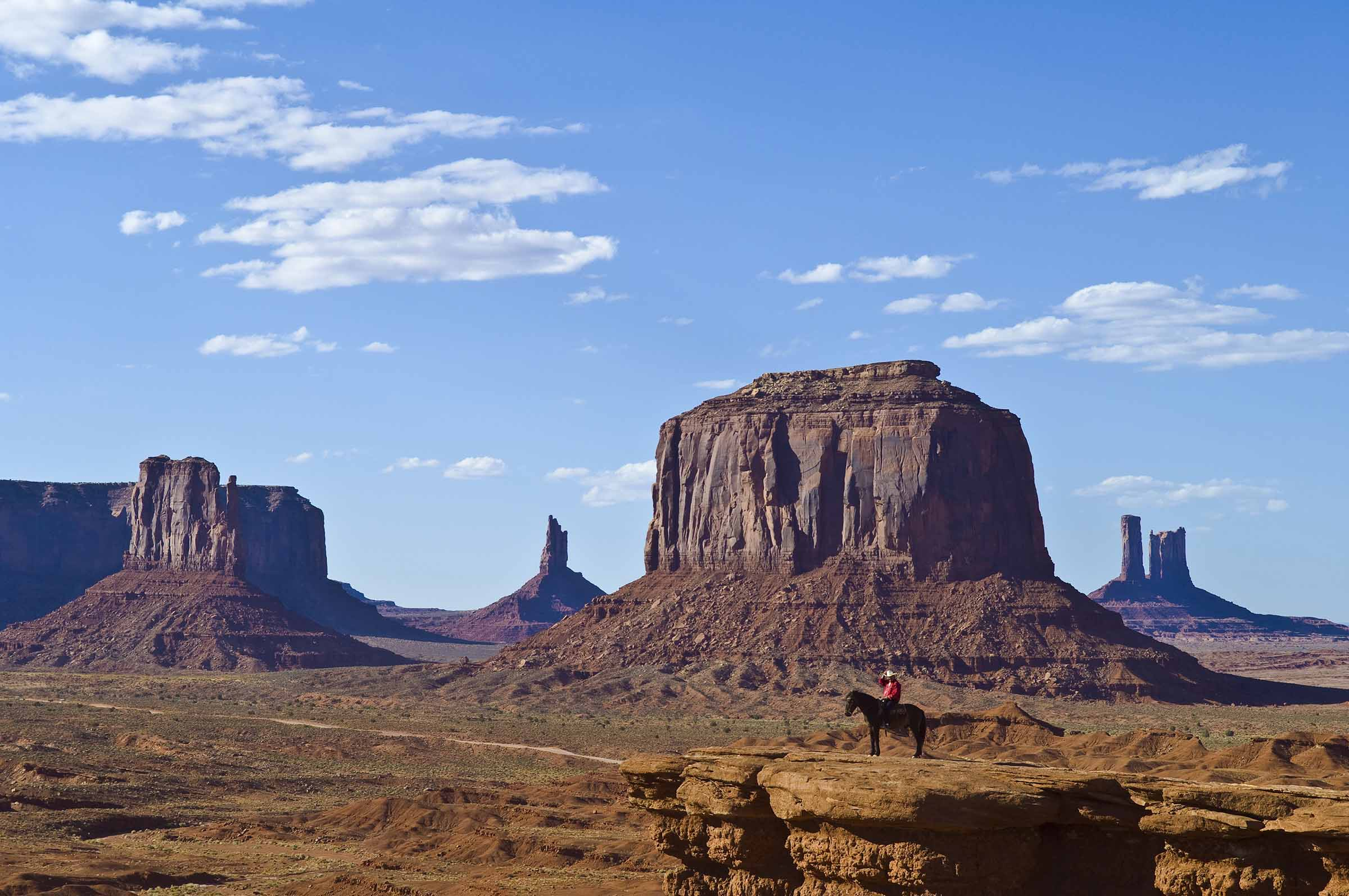 Monument Valley with Navajo man posing on horseback at John Ford?s Point; Monument Valley Navajo Tribal Park on the Utah-Arizona border.